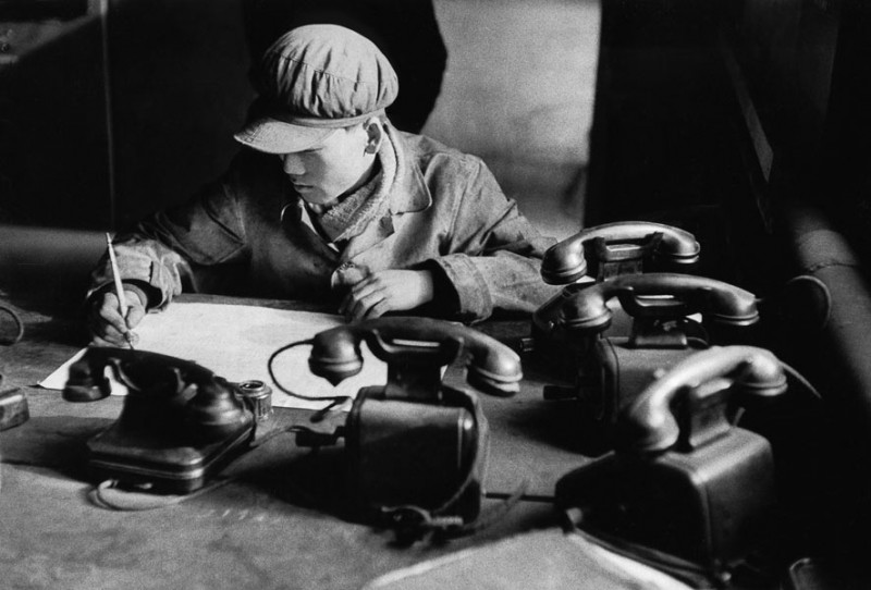 Anshan, China, 1957. The engineer in this steelworks needs a separate phone for every line - switchboards only arrived fifteen years later.
