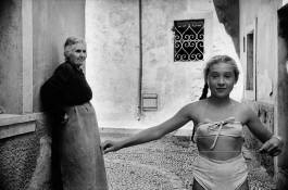 "Yougoslavia, 1953. A young girl wears a ""bikini"" in Dubrovnik small streets, under the disapproving look of her grandmother."