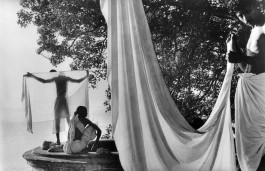 "India, 1956. After bathing in the Ganges, Hindus dry their ""dhotis"" in the sun."