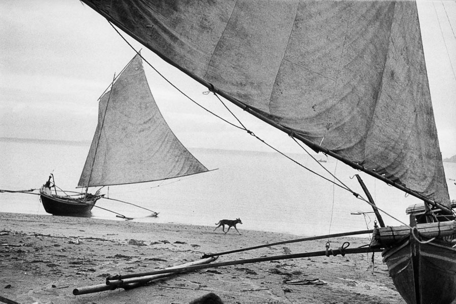 Indonesia, 1957. A beach in evening light.