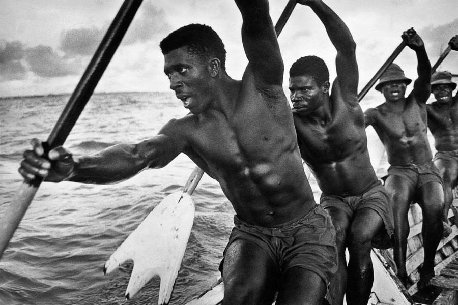 Ghana, 1960. The boatmen chant as they paddle.