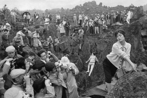 Japan, 1958. Japan's first photography festival. Models provided by Fuji pose at the volcanic site of Karuizawa to the great delight of amateur and professional photographers.