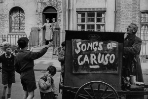 Barrel organ player, London, 1954