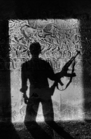 Shadow of a soldier on the bas-reliefs of Angkor Vat, 1990