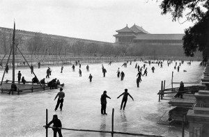 Ice-skating on a frozen canal along the Forbidden City, Beijing, 1957