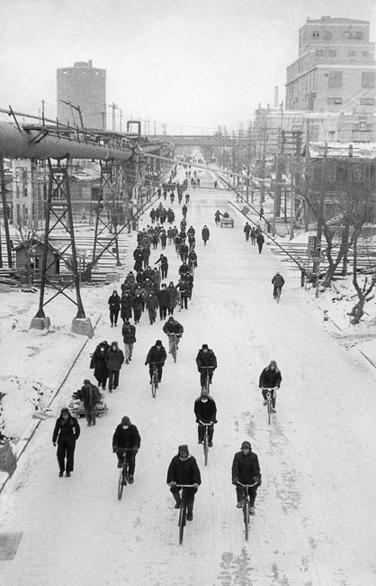 Workers leaving a factory at the end of the day, Anshan, 1957