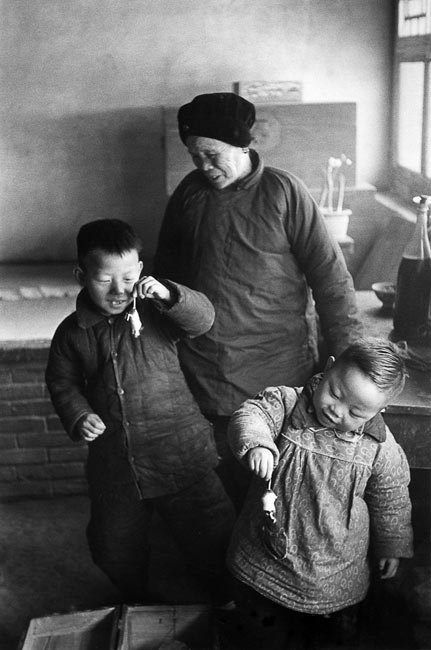 Children playing with mice, suburb of Beijing, 1957