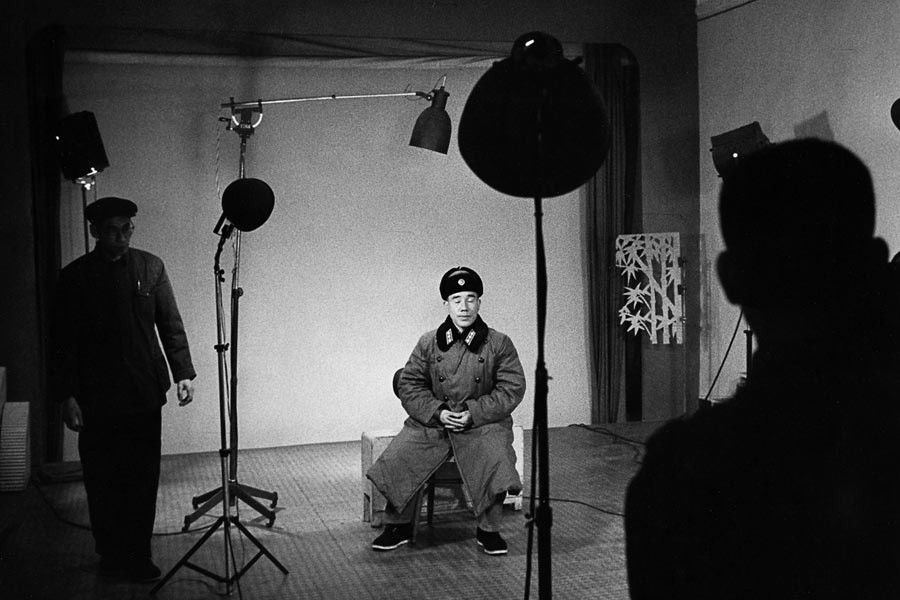Soldier at a photographer's studio in Beijing, 1965
