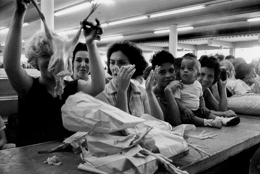 In a supermarket of Vedado neighborhood, Havana, the purchases can be made with rationing tickets, 1963