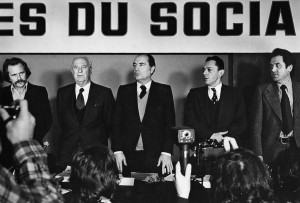 François Mitterrand in a Parti socialiste convention, on the left Régis Debray and Gaston Deferre, on the right Michel Rocard. Paris, 1974