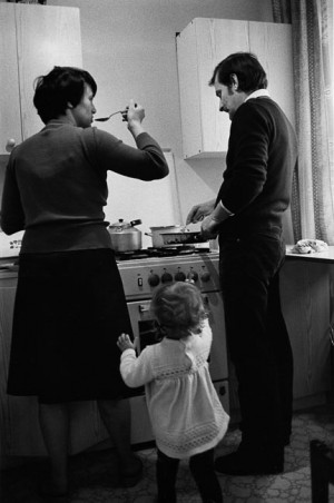 Lech Walesa with his wife and one of their children in the kitchen, Poland, 1980