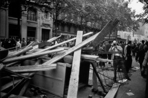 Rue de Lyon, Henri Cartier-Bresson is photographing over the barricade