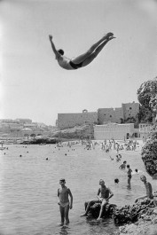 Yougoslavia, 1953. A man diving in front of Dubrovnik walls.