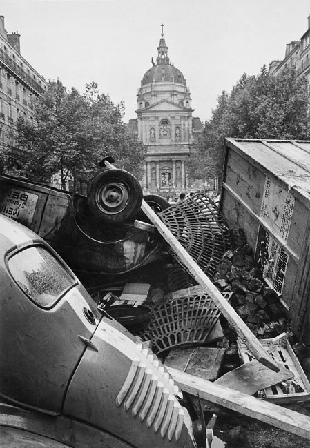 France, May 1968. Sorbonne chapel over a barricade.