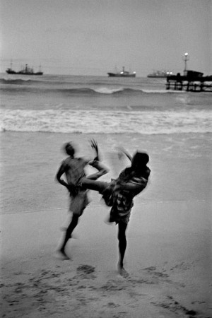 Ghana, 1960. Two boys on the beach in Accra in the evening. Are they fighting or inventing a new dance?