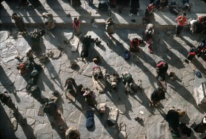 In front of the Jokhang, Lhassa temple, the pilgrims, coming from whole Tibet, bow down several times. 1985