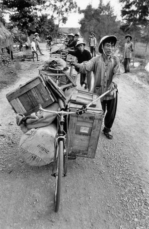 Carrying equipment on bicycles, North Vietnam, 1969