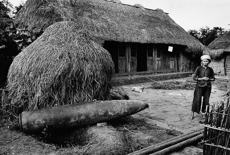Bomb fallen in the courtyard of a farming cooperative in the area of Phat Diem, 1969