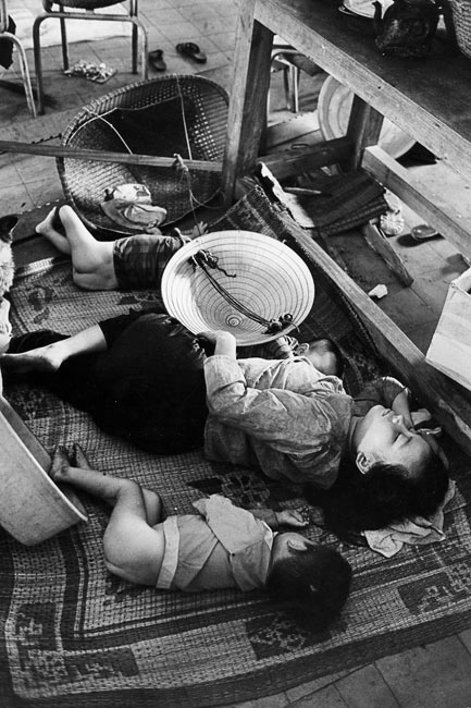 Inhabitants of Hué who took shelter in Quoc-Hoc high school after the long battle which destroyed a great part of the city, April 1968